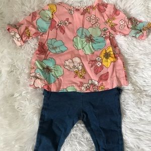 A casual baby girl's outfit created by Carter's.